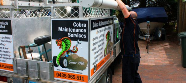 A Cobra plumber with the Cobra Plumbing Ute wollongong